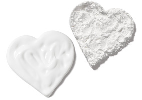 Mary Kay Naturally Exfoliating Powder and Purifying Cleanser in heart shaped rubs
